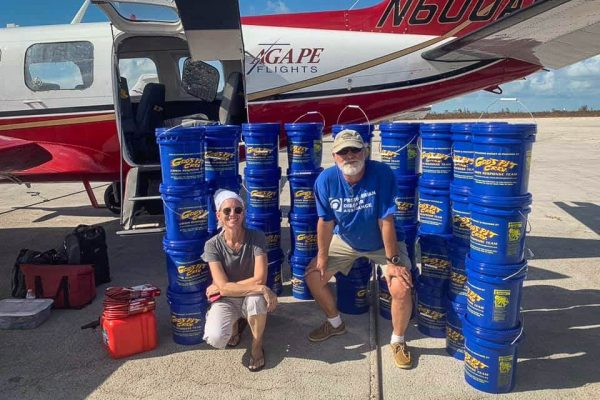 God's Pit Crew partnered with Agape Flights to have Blessing Buckets and other essential relief supplies delivered to the Bahamas just hours after Hurricane Dorian.