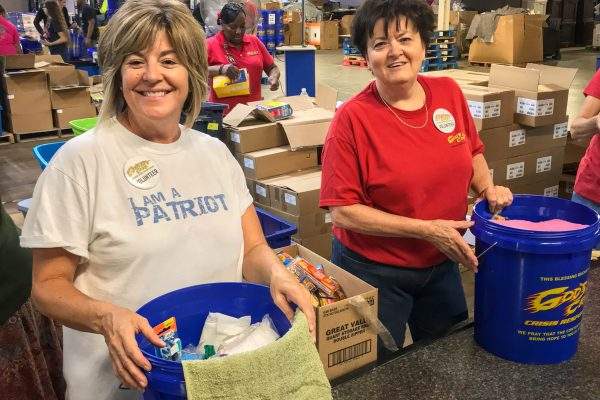 Volunteers work together to assemble Blessing Buckets at the GPC Distribution Center.