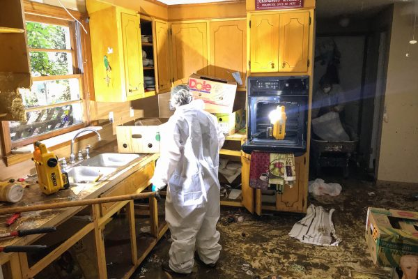 A volunteer works to clean out a home in Danville, VA, that was destroyed by a flash flood as a result of Hurricane Michael in October 2018.