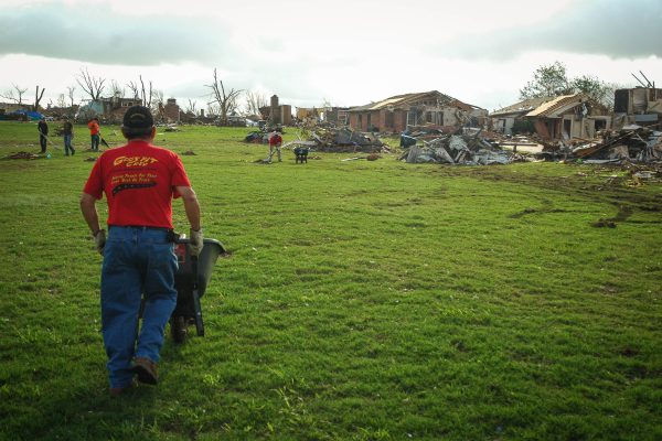 A GPC Volunteer works to clean up debris after a tornado in Moore, Oklahoma.