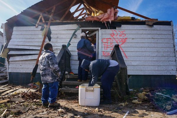 Church members in Tappahannock, Virginia, work together to salvage items out of their church building, which was destroyed by a tornado in 2016.